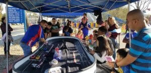 Nomad Oval racetrack in action at street fair.