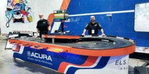 Nomad Raceways Quadrophenia slot car track ready to perform at the Acura Long Beacch Gran Prix Fan Zone.